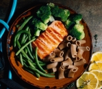 Tender salmon trout with green vegetables and fresh pasta