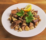 Veal tongue with mushrooms in butter