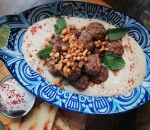 Turkish meatballs over bean hummus with labne, pine nuts and pita bread