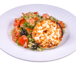 Quinoa salad with tomatoes and roasted goat cheese