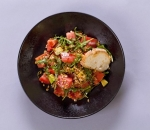 Salad with emmer wheat, avocado, ruccola and tomatoes