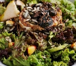 Mix salads with roasted goat cheese
