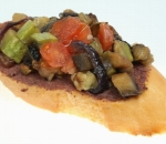 Tapas with zucchini ragout, eggplant, tomatoes and olive paste