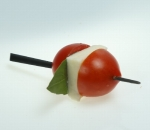 Cocktail skewer with cherry tomatoes, mozzarella and basil