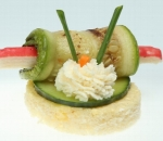 Bite with grilled zucchini, crab roll, fresh cucumber mousse and milk