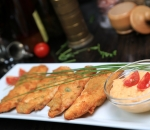Chicken bonfillets with parmesan and warm sauce