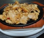 213. Chicken on a plate with spicy sauce and onions