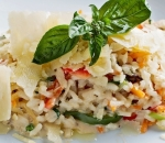 Risotto with chicken fillet, vegetables and parmesan