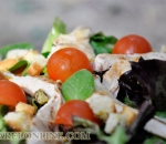 Spinach salad, chicken and cherry tomatoes