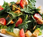 Colorful leaf salads with spinach, hummus, mustard dressing and croutons