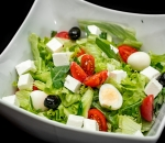 Mix of fresh salads with quail eggs