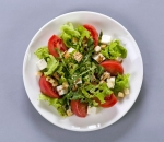 Pink tomatoes and fresh cheese salad