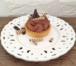 Chocolate tartlet - crispy biscuit base in combination with brown garash cream and light chocolate mousse