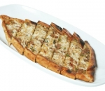 Pide with minced meat and yellow cheese