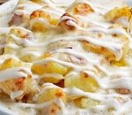 Baked potatoes with bacon, ham, cheese and garlic sauce