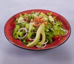 Green salad with smoked salmon and roasted seeds