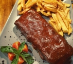 Delicate pork ribs glazed with barbecue sauce Padre