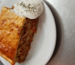 Moussaka with minced meat and baked potatoes