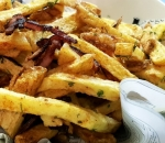 Homemade french fries with crispy bacon