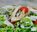 Green salad with chicken, parmesan and green pips