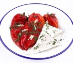 Roasted pepper with garlic, dill and a plate of cheese