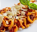 Tagliatelle with beef fillet, cherry, parmesan in tomato sauce with garlic