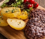 Young beef meatballs with baked potatoes with herbs