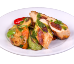 Larded chicken fillet with sauteed vegetables