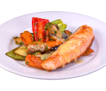 Grilled salmon fillet with sauteed vegetables and orange sauce