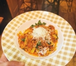 Fresh pasta with beef stew and parmesan