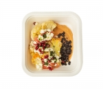 Cauliflower steak with black beans, pomegranate and cheese