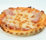Pizza with ham, cheese and tomato sauce