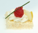Bite with red caviar and cream mousse