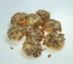 Balls of yellow cheese and seeds