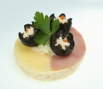 Ham with ham, yellow cheese, olives, milk mousse