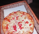 Small pizza with chicken fillet and roasted pepper