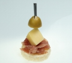 Bite with Emmental, prosciutto and green olive