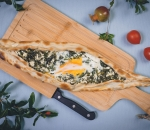 Pide with cheese, spinach and egg