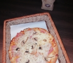 Small pizza with ham and mushrooms