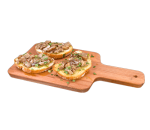 Bruschette with mushrooms in a pan