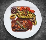 Veal steak with mushroom sauce and grilled vegetables