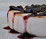 Camembert baked with blueberry jam