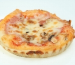 Pizza with ham, mushrooms, cheese and tomato sauce