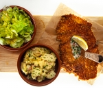 Pork schnitzel with potato salad and French dressing