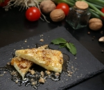 Baked cow's cheese with honey and walnuts