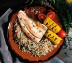Plain trout on a plate with roasted corn and quinoa