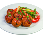Fried beef meatballs garnished with tomatoes
