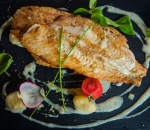 Seafood fillet with potato gnocchi and dill sauce