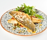 Grilled sea bass fillet with garden capon and sliced almonds