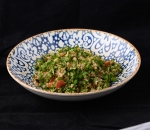 Table with quinoa and spicy dressing